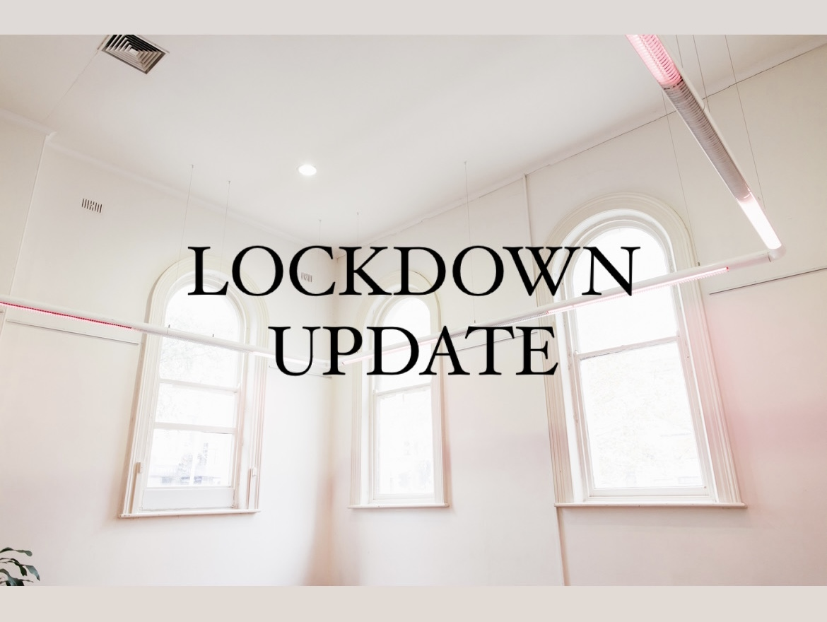 Image of three arch windows, with a light fixture with pink gels. Text overlay reads Lockdown Update